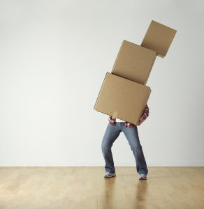 A man carrying moving boxes in which to pack your antiques for moving.