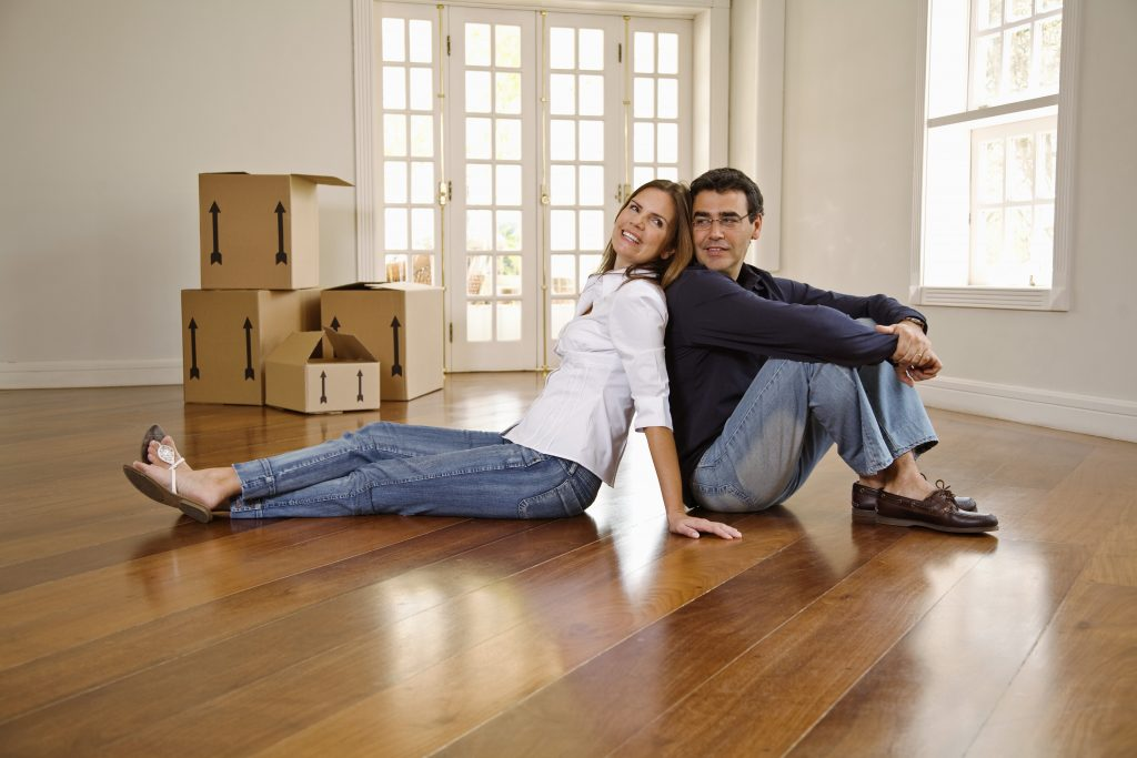 Couple sitting in new home, representing movers Orange NJ