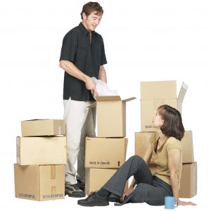 Man and woman packing boxes for moving