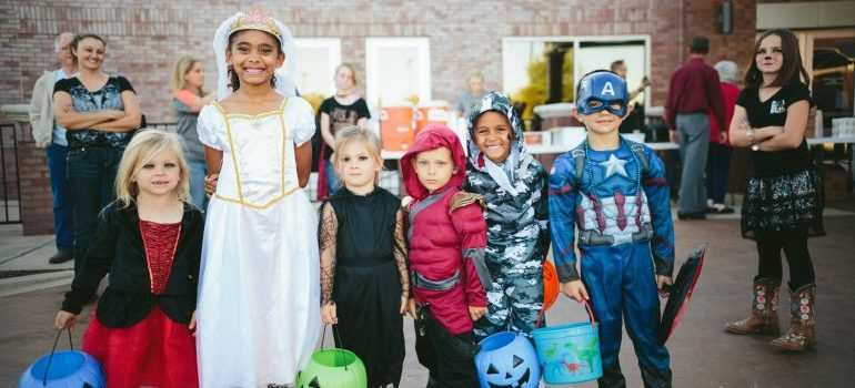 Kids in costumes trick-or-treating as a way to celebrate Halloween in New Jersey